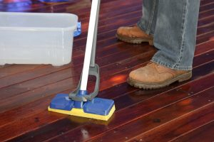 Apply Sikkens Cetol BL Deck & Wood Cleaner to wet decking boards